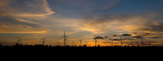 Wind turbine power generator with panorama at twilight time photo