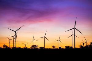 Wind turbine power generator at twilight photo
