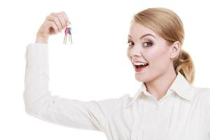 Woman real estate agent holding set keys to new house photo