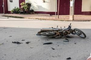 Broken Motorcycle on Street photo
