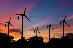 Wind turbine power generator at twilight background