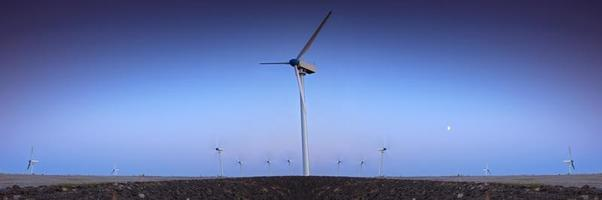 Wind turbine farm with blue sky in the evening