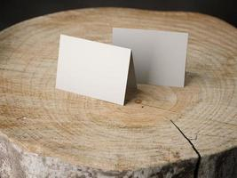 Two business cards on the stump photo