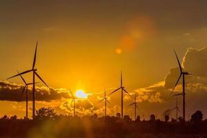 Wind turbine power generator silhouette at sunset