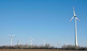 Power generating windmills with beautiful blue sky photo