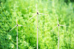 Green blurred background wind turbines