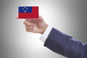 holding a business card with Samoa Flag photo