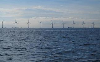 wind turbines power generator farm in sea photo