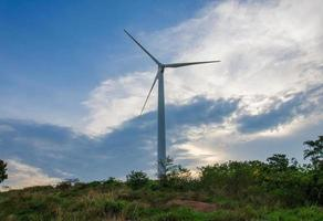 wind turbine generating electricity on hill photo
