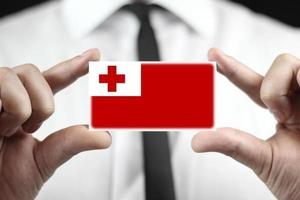 Businessman holding a business card with Tonga Flag