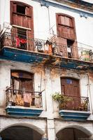 Apartment building in downtown Havana Cuba with laundry photo