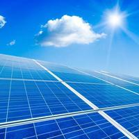 Solar panel against blue sky photo