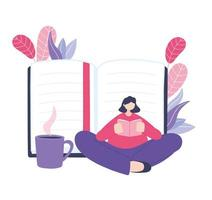 Woman sitting and reading book in front of notebook