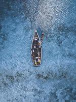 Aerial of people in boats on water photo