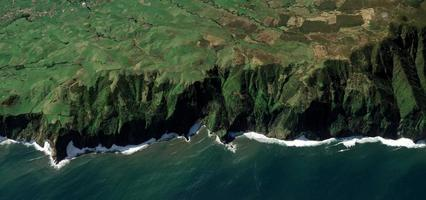 Aerial of cliff near water