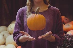 Woman catching pumpkin