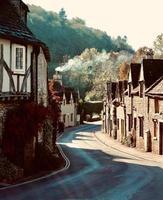 Road between brown brick houses