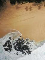 Water hitting rocks on shore