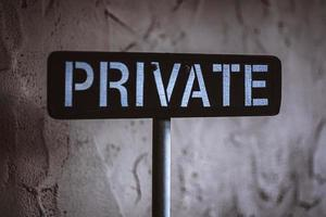 Private sign on white wall