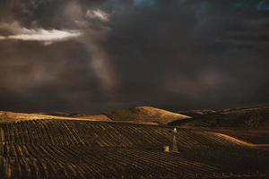 Farmland under stormy sky