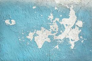 pared pintada de azul desgastado foto