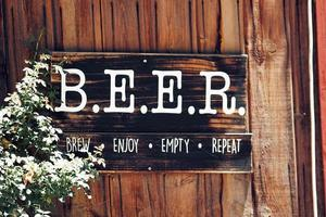 Wooden text signage saying beer