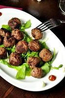 Meatballs on oval white plate