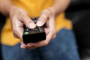 Close-up of person holding remote