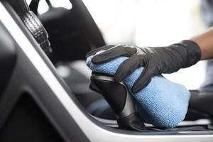 Person cleaning interior of car