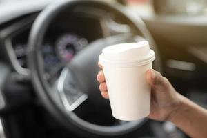 Close-up of hand holding to-go cup