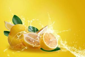 Water splashing on fresh sliced ripe yellow lemons