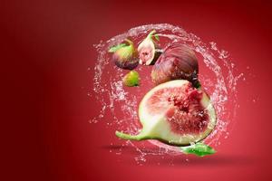 Water splashing on fresh figs