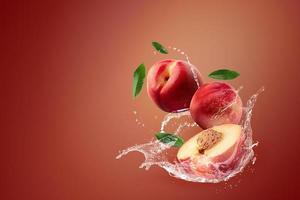 Water splashing on fresh nectarines