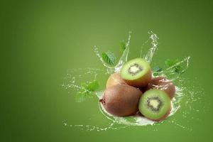 Water splashing on kiwi fruit