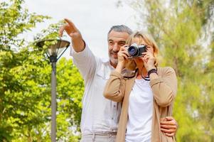 Couple taking photos in park