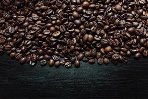 Coffee beans over a dark wooden background