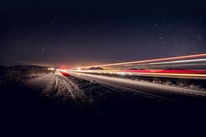 Time lapse photography of vehicles on road