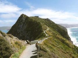 Walking path through green mountain photo