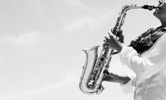 Saxophonist playing on saxophone photo