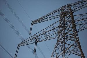 Electricity pylon at dusk, Dibba, Fujairah, United Arab Emirates photo