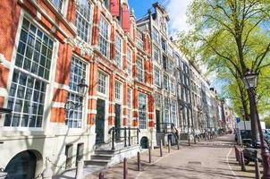 Amsterdam street with 17th century residence buildings. photo
