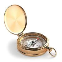 Gold compass on white isolated background. photo