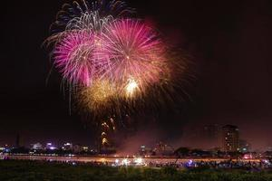 Colorful festival fireworks at the river