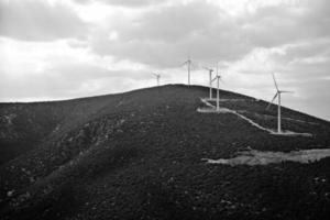 Wind electricity turbine on a mountain photo