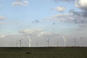 wind turbines and blue sky with clouds photo