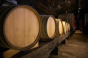Wine barrels in cellar photo