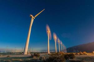 Wind Turbines in desert during sunrise time photo