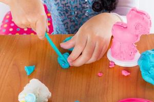 Little girl play colorful dough