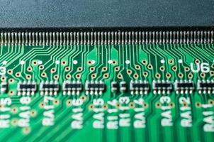 closeup of leg chip and transistor electronic board photo