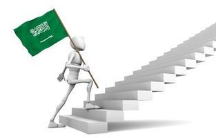 chico caminando libremente hacia la cima y lleva la bandera saudi_arabia foto